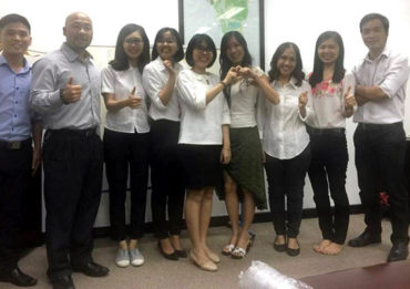 International Lawyer Ken Duong (second from left) and students attending free English classes.